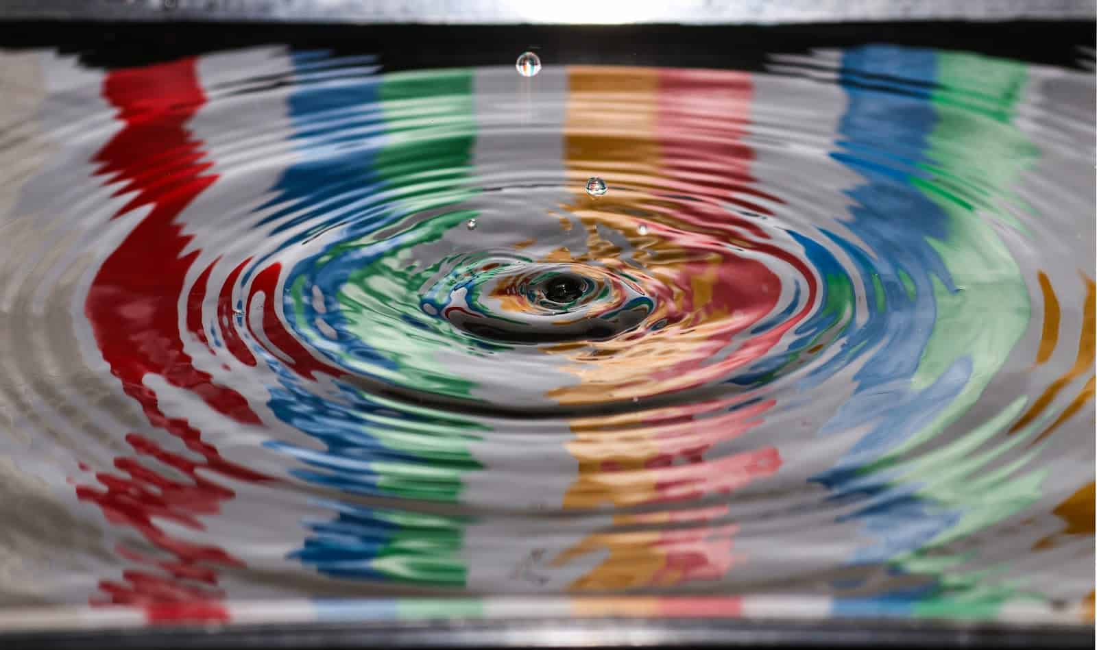 painting in water with a drop in the middle
