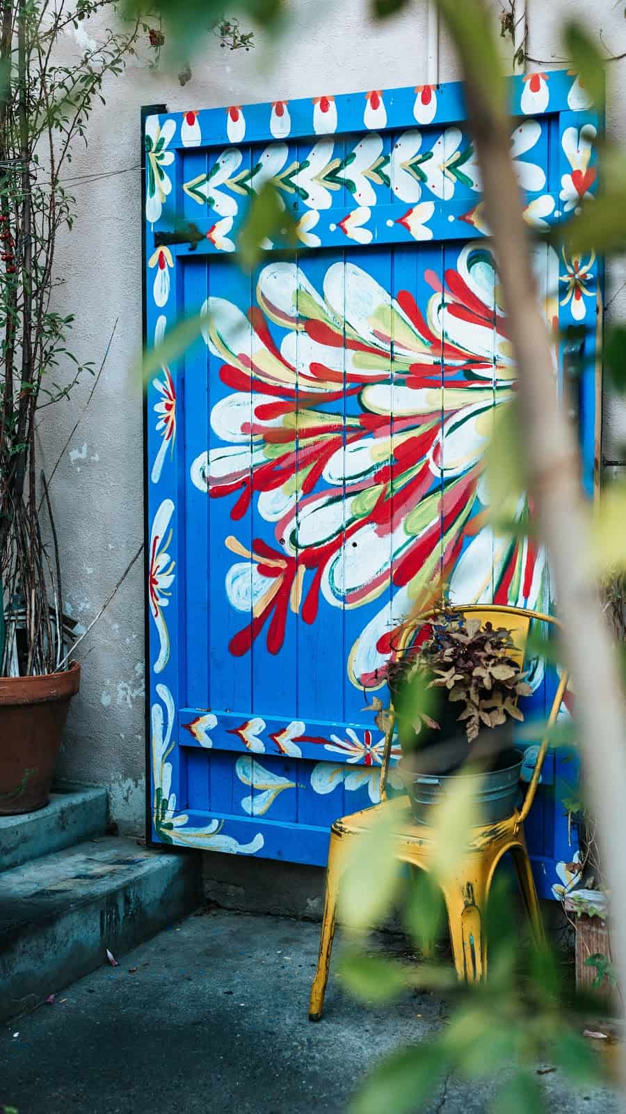blue door with a white and red painting on it