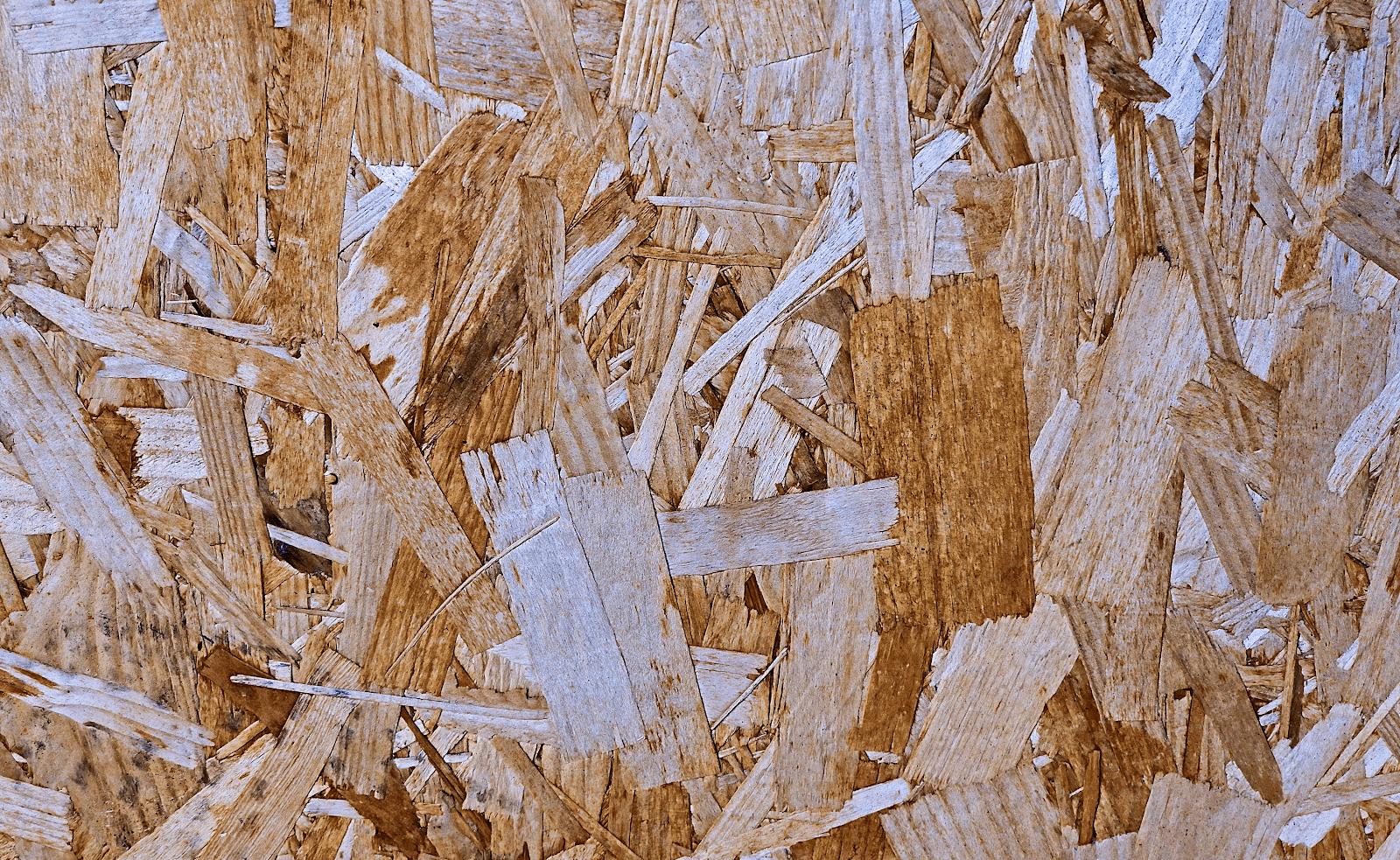 compress wood fibers