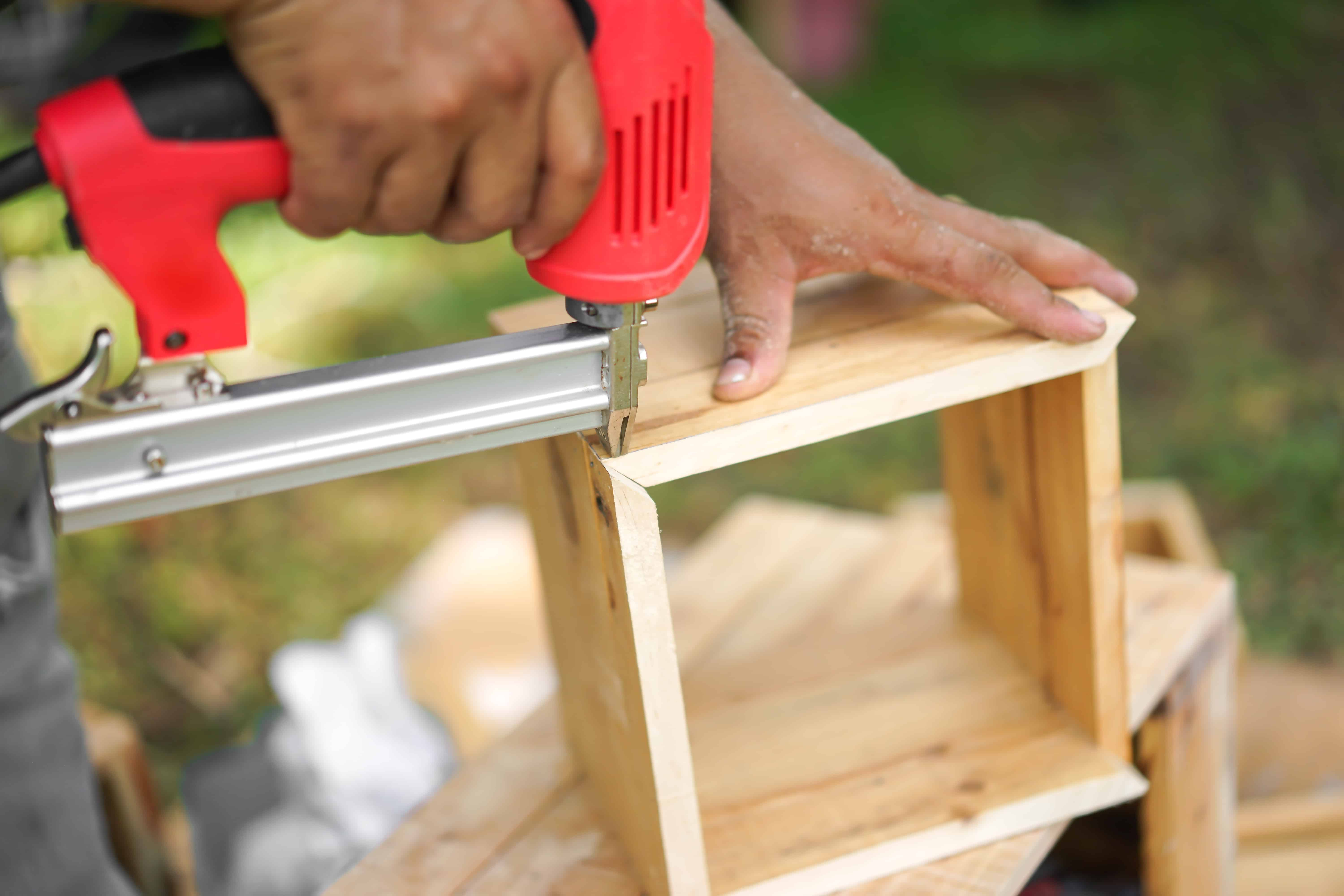 Electric brad nailer used for building a wooden box