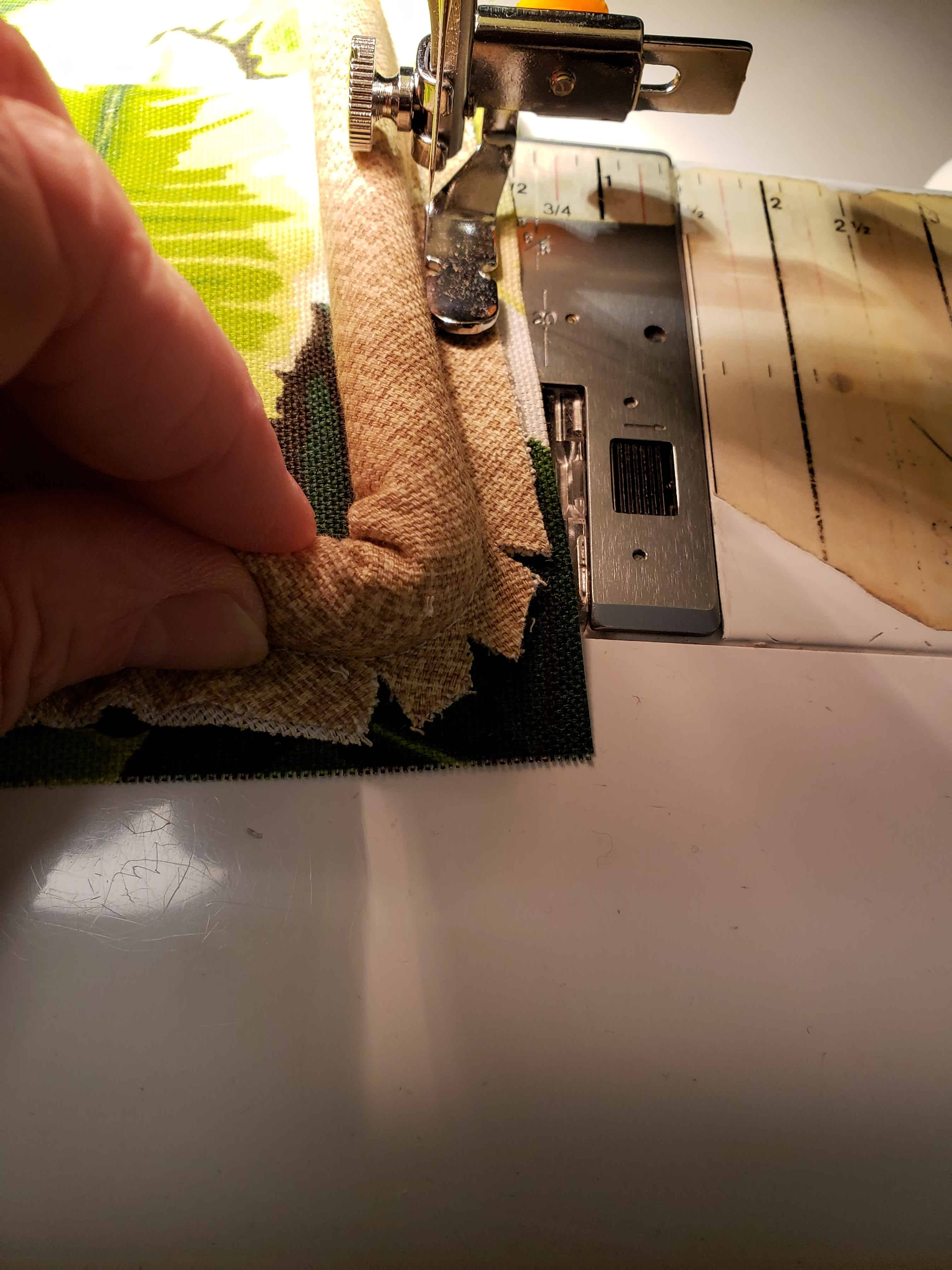 sewing the bias cording to the pillow front