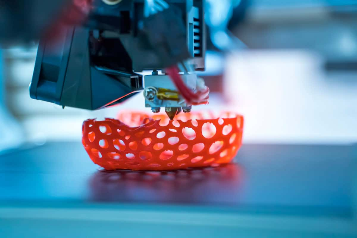 3D printer printing red object
