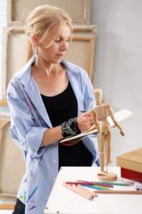 woman sketching mannequin best poseable artist mannequin verycreate.com