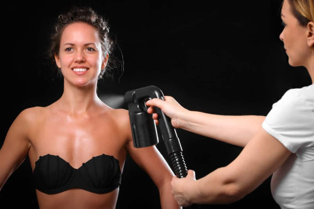 woman being spray tanned Best At Home Tanning Machines verycreate.com