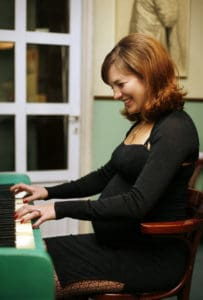 pregnant woman at piano Is it possible to learn piano online verycreate.com
