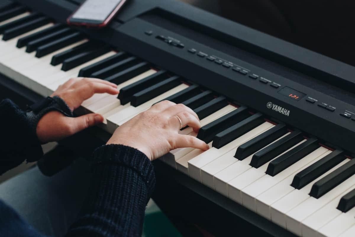 keyboard with hands How many keys do i need to learn piano verycreate.com