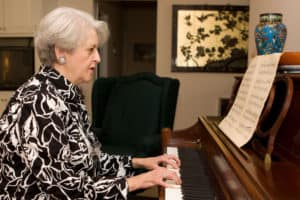 senior woman at piano Is It Too Late To Learn The Piano verycreate.com