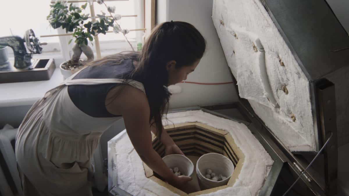 woman with her kiln in home best kiln for home use verycreate.com