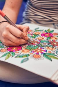 woman coloring flowers best markers for adult coloring books verycreate.com