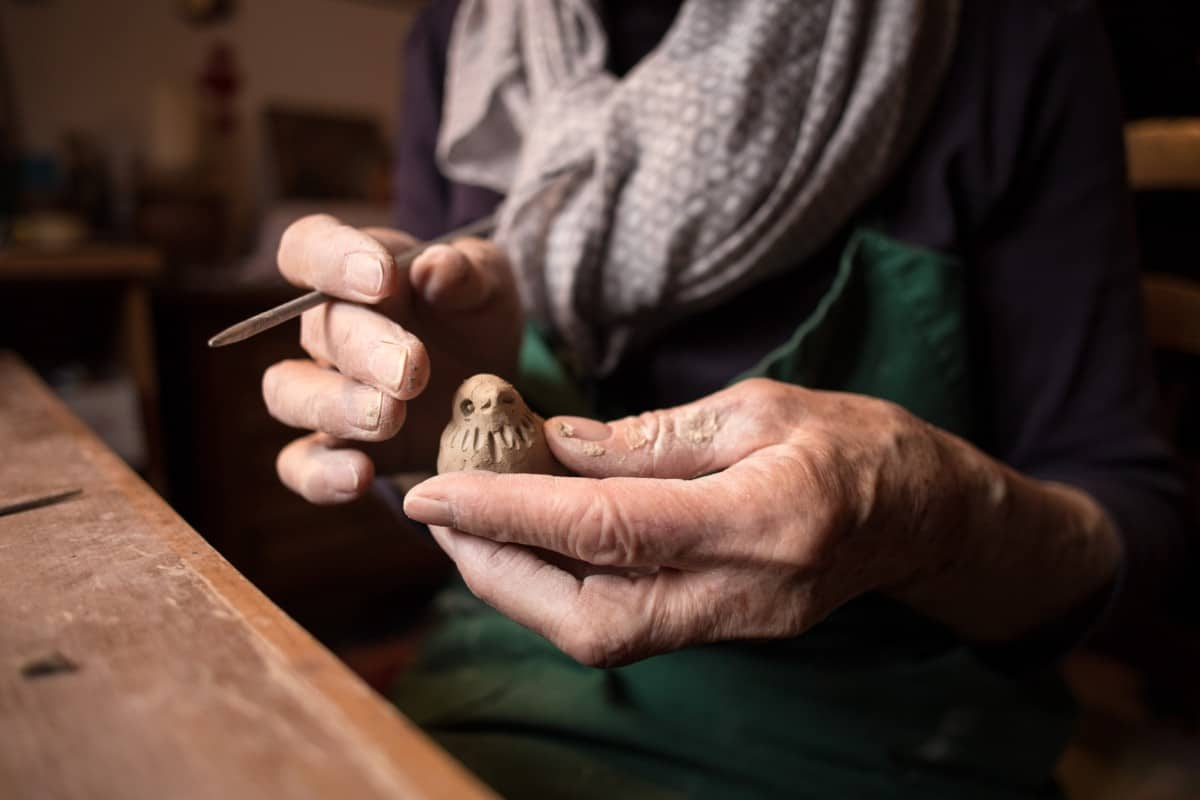 woman carving bird clay can you bake air dry clay in an oven verycreate.com