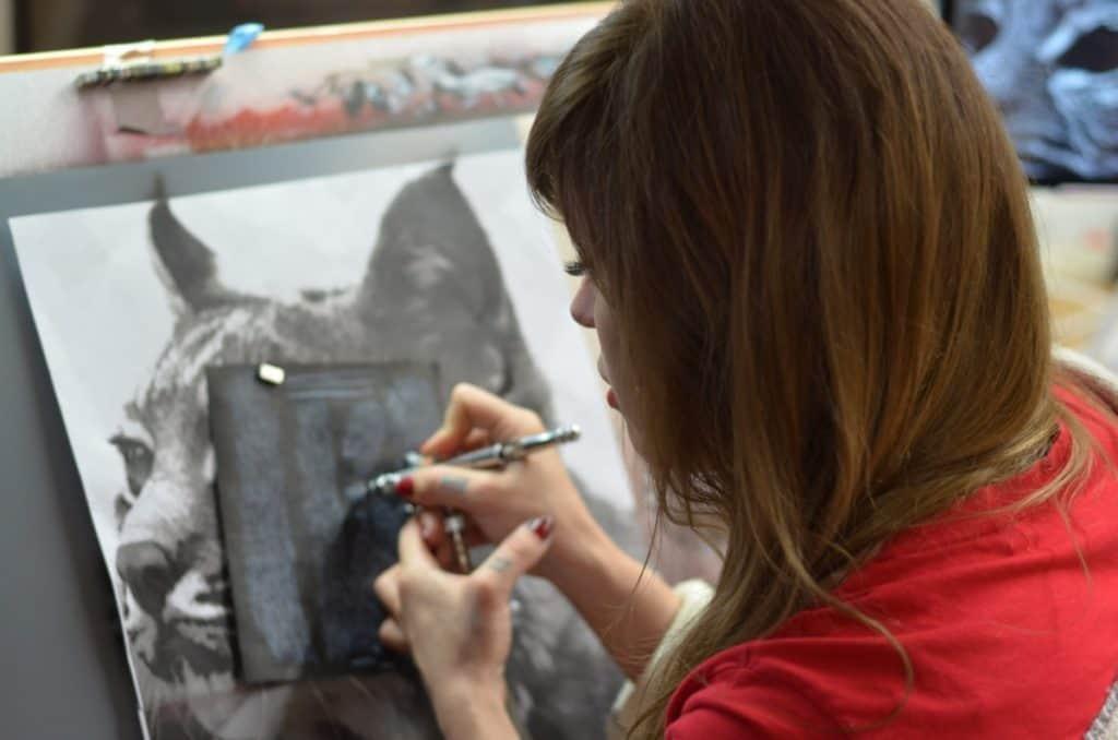 woman using a stencil airbrush basics verycreate.com